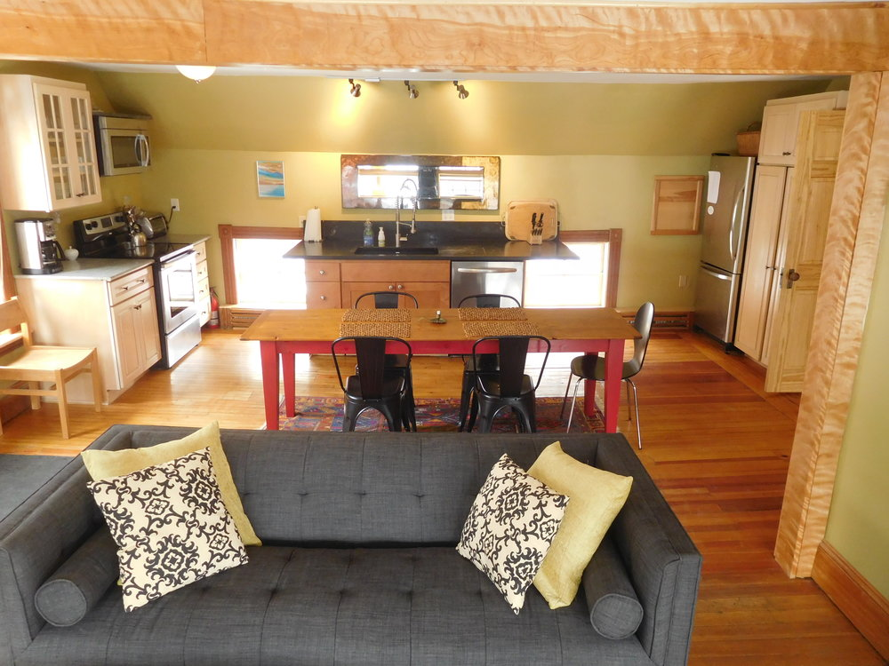 Carriage House living room and kitchen. Spacious common area