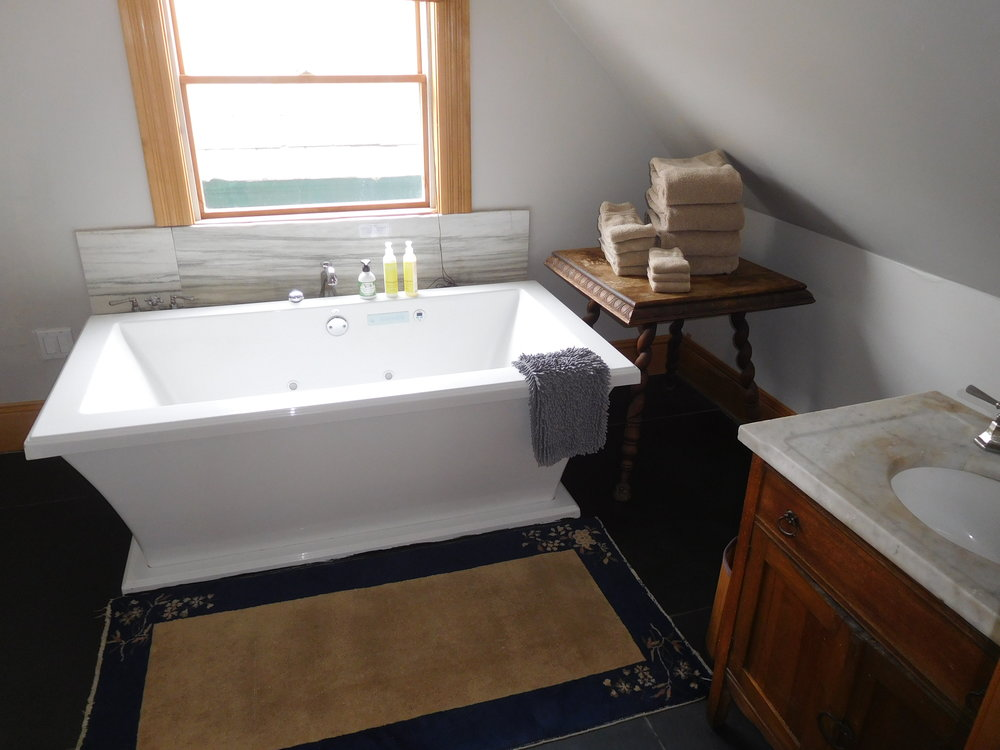 Carriage House upstairs bathroom, bubbler jetted soaking tub. slate floor