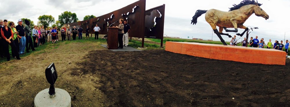 The unveiling ceremony for John's mustang sculpture. Photo credit: Oak Kelsey.