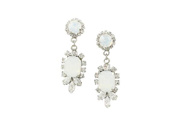 Resembling the milky hue of an opal, the center stones of these earrings are surrounded with crystal gems .  They combine the best of both - a bejeweled stud delicately attached to its bejeweled drop down.  $98