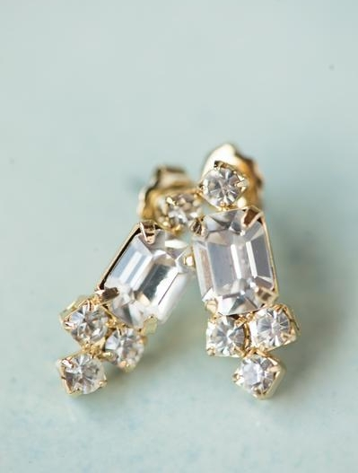 "The emerald cut center of these light catching stud earrings are surrounded by smaller round crystals.  Just the right size to draw attention and have them guessing if they are ""real"".  $58"