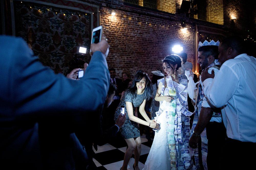 London wedding reception at Hatfield House Sophie Anwar photography August weddings Greek dancing wedding reception