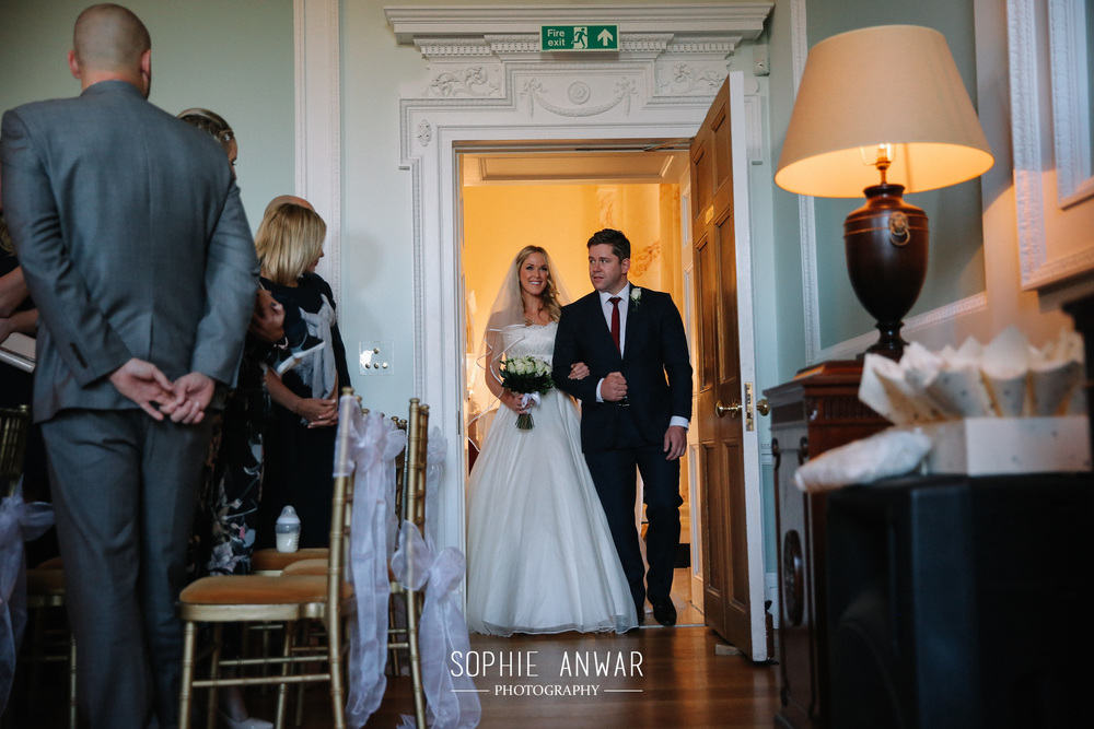 bride walks down the aisle at Botley Mansin Manor Surrey London clivil ceremony Pinner Ruislip Northwood Moor Park Luxury wedding ceremony