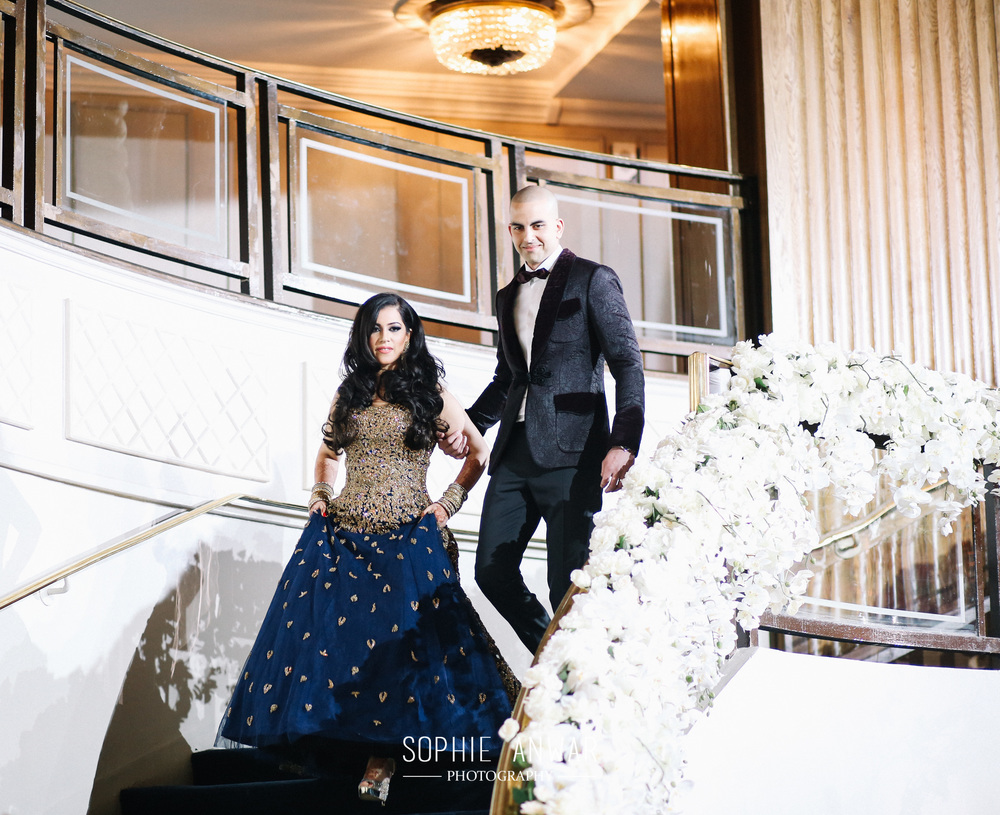 Luxury Asian wedding photography Grosvenor house park lane london luxury asian wedding photographer sophie anwar  bride and groom entrance to reception