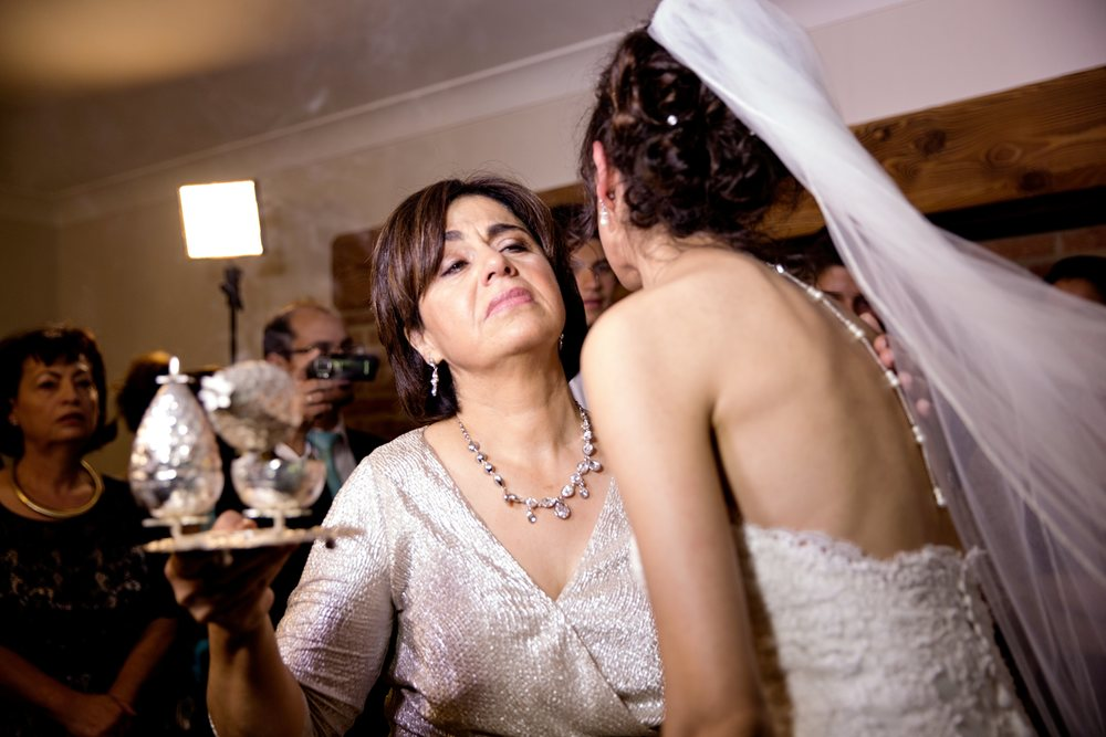 Mother and bride Greek wedding traditions at home - london wedding photographer