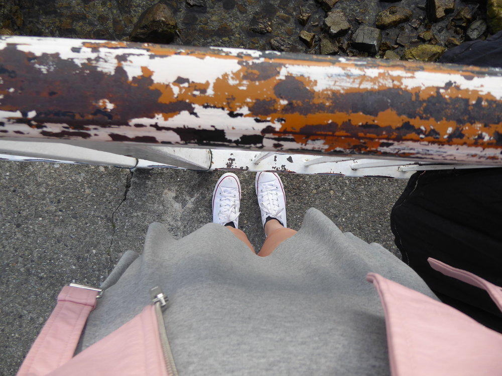 Here's a picture of my outfit: Grey H&M dress, pink Zara jacket, and comfy white converse.