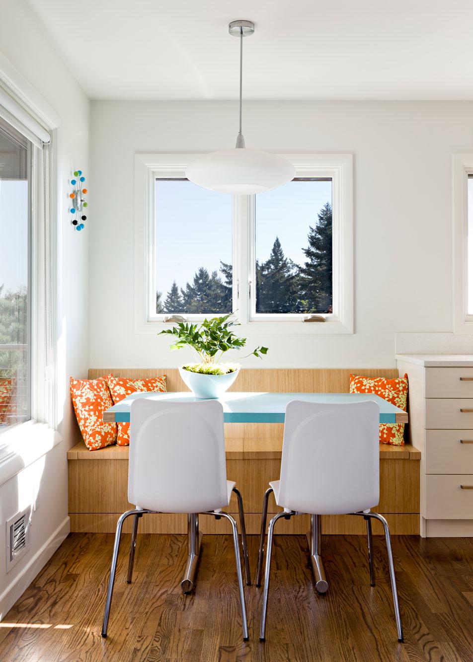 Breakfast nook featuring custom merkeled table