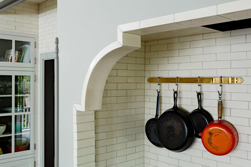 Custom tile corbel at stove alcove