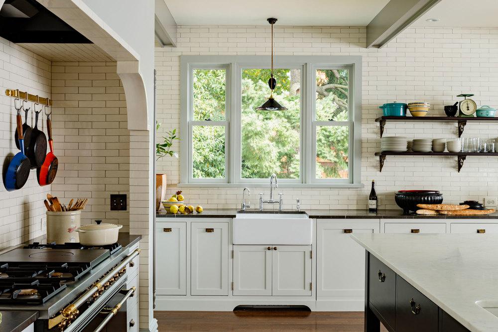 Sink, range niche, open shelves