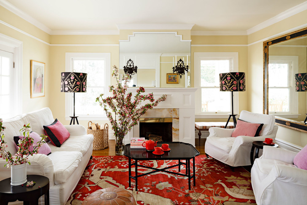Living room with custom rug, lampshades, and JHID-designed bench