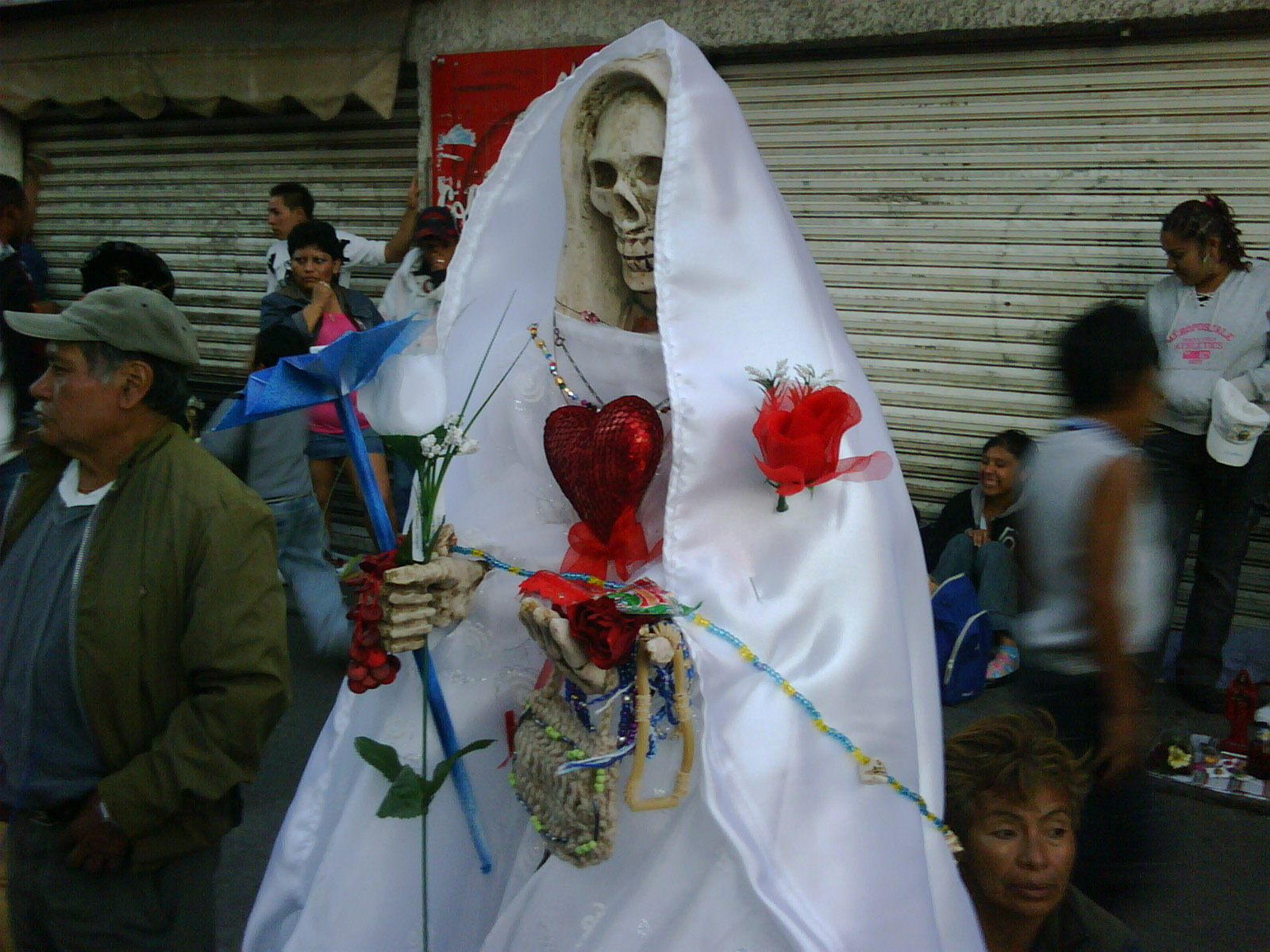 santa muerte is the patron saint of criminals, or so i'm told. you pray to it so you won't get caught.