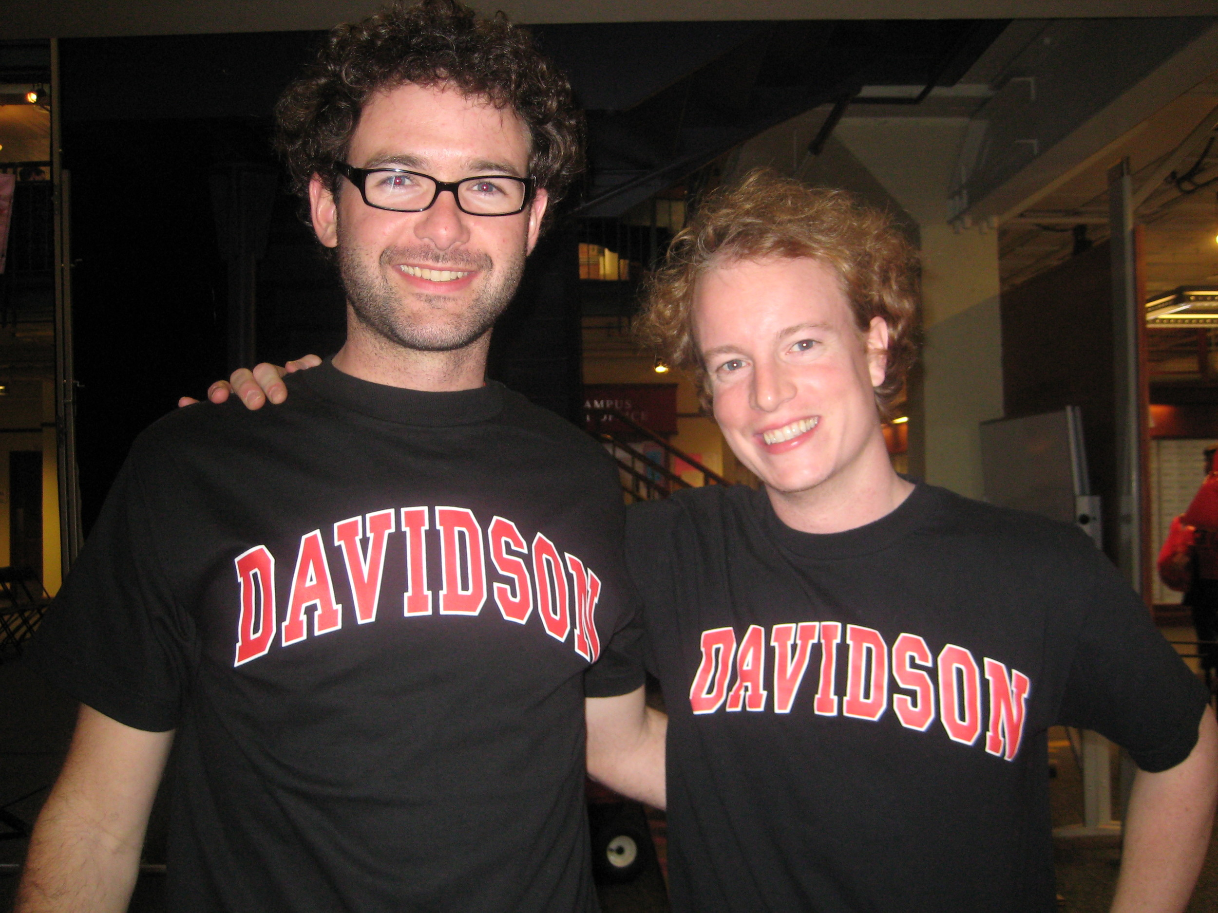 david and chris with their newly purchased black out shirts