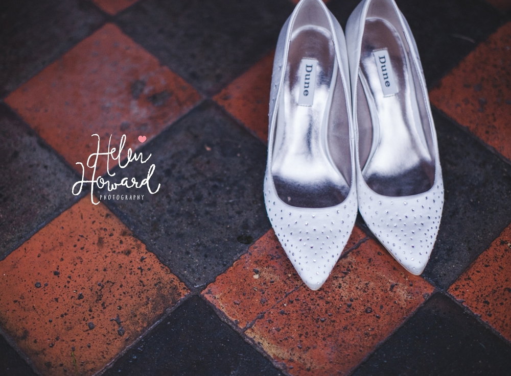 Bridal shoes on a tiled floor