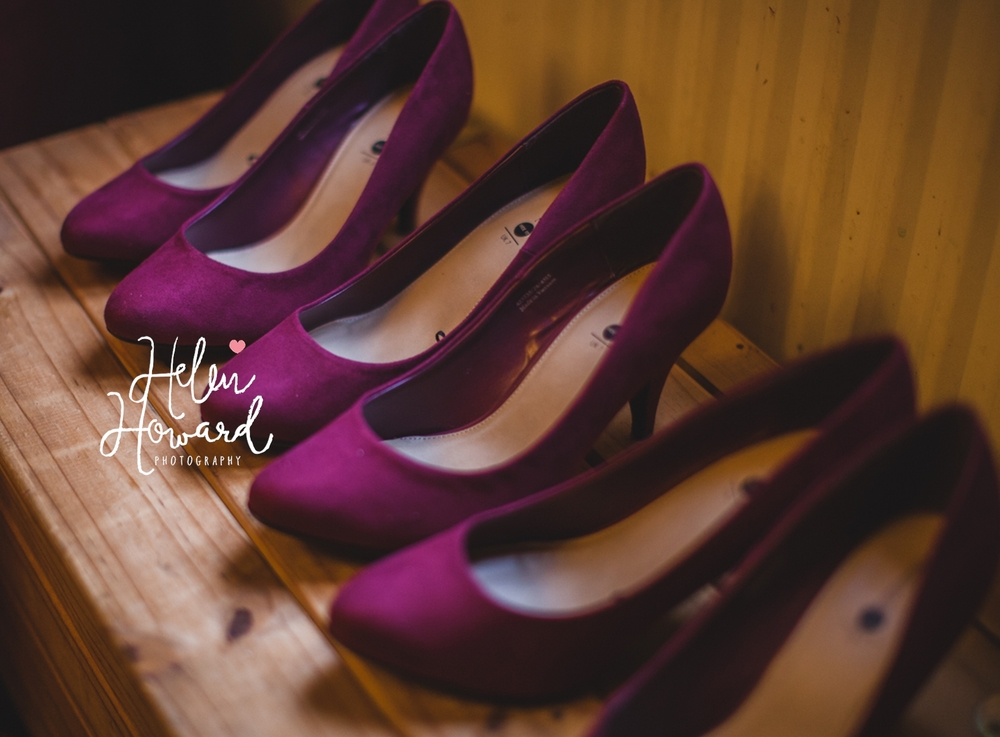 three pairs of bridesmaid's shoes