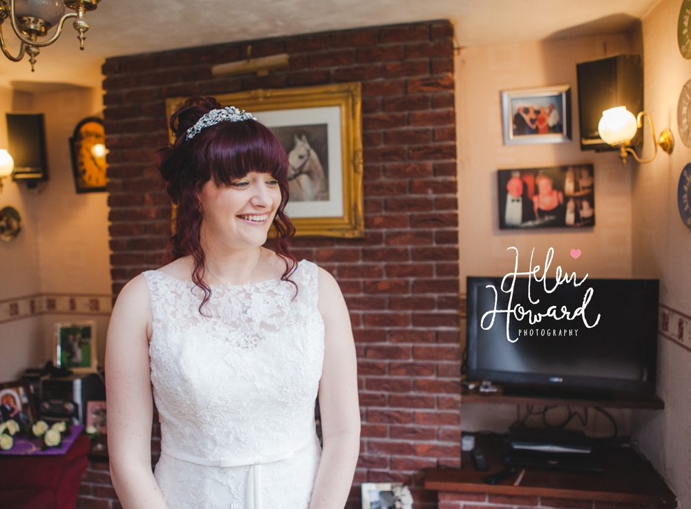 staffordshire bride smiling on the morning of her wedding Helen Howard wedding photographer near Birmingham