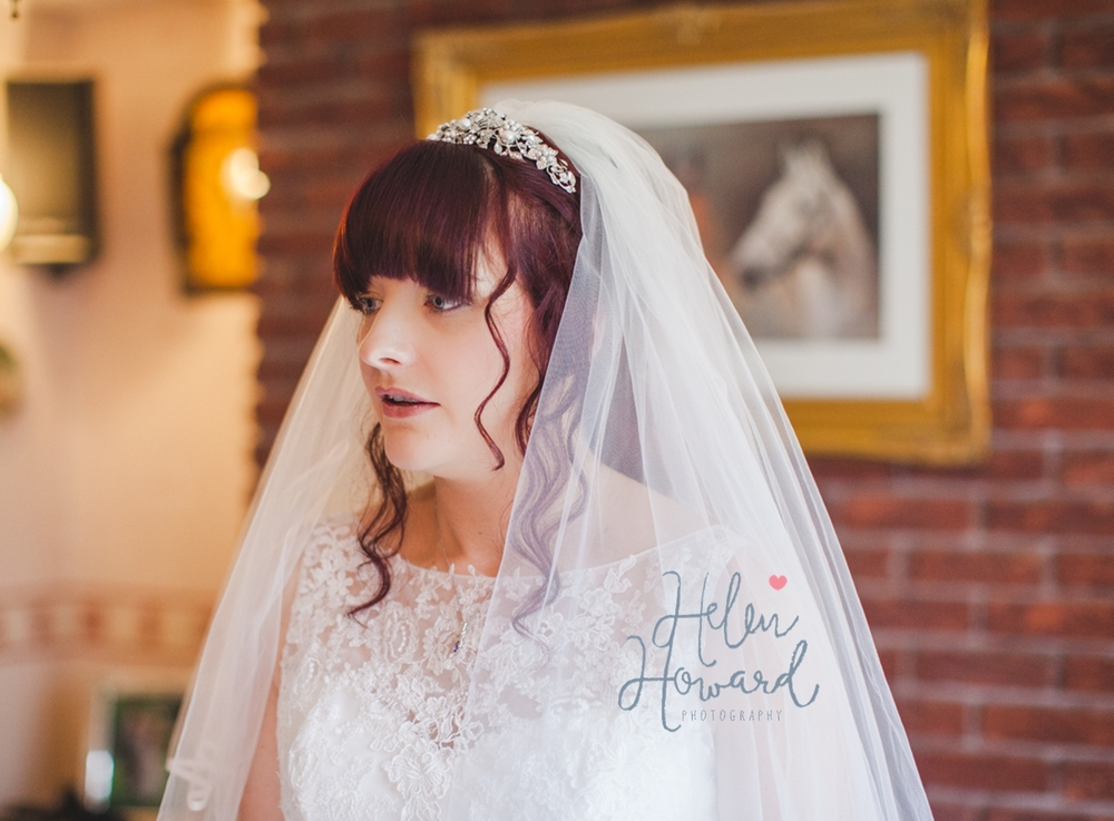 A bride with red hair and a veil
