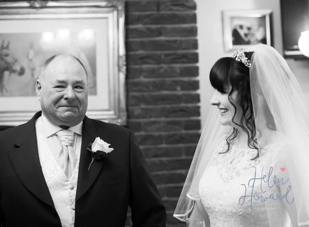 Black and White image of a proud father and his daughter on her wedding day