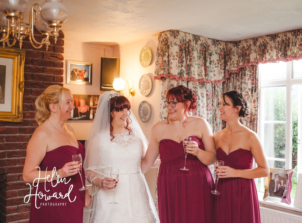 A bride with her bridesmaids Staffordshire Wedding Photography