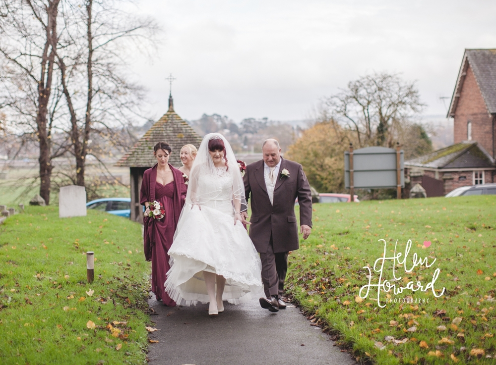 Wedding Photography in Staffordshire Bride and her Father walking to the church