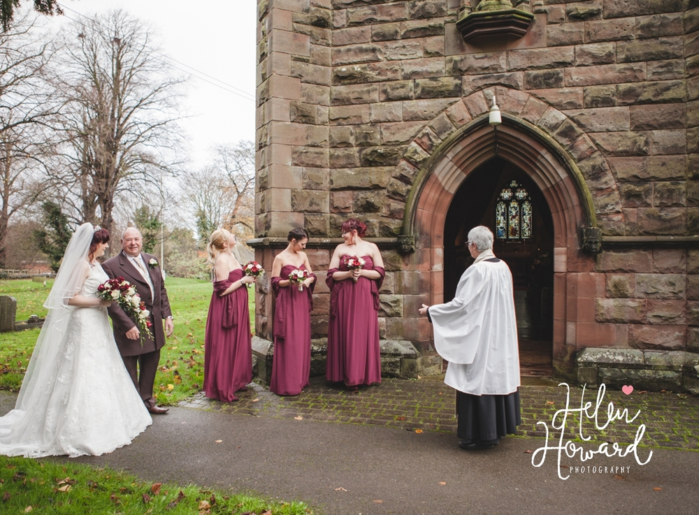 Wedding party waiting outside the church in Dusnton Staffordshire
