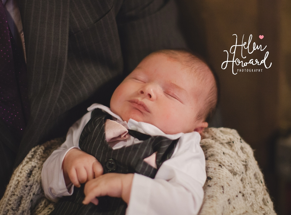Cute newborn baby in a baby tux