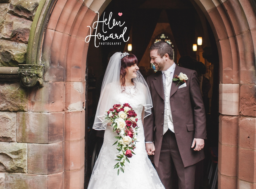 Newly Married couple outside of their church wedding photography staffordshire