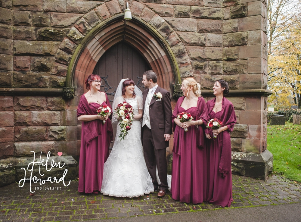 Bride and Groom with their bridesmaids outside the church