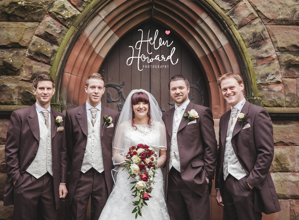 Bride and Groom with the groomsmen in front of the church door
