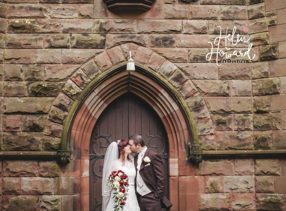 Portrait of a bride and groom outside St Leonard's Church in Dunston
