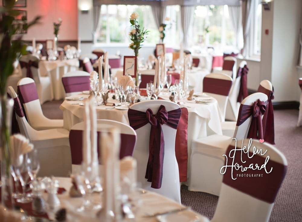 Wedding at The Moathouse in Acton Trussell with white chair covers and Red sash