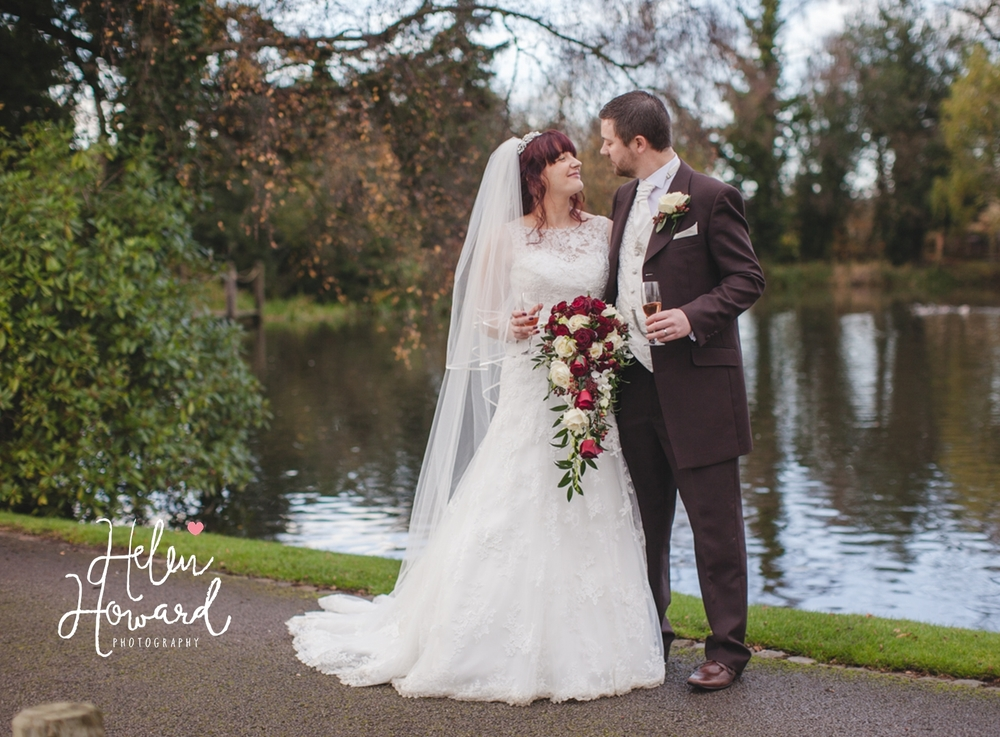 Bride and Groom by the water at The Moathouse Acton Trussell