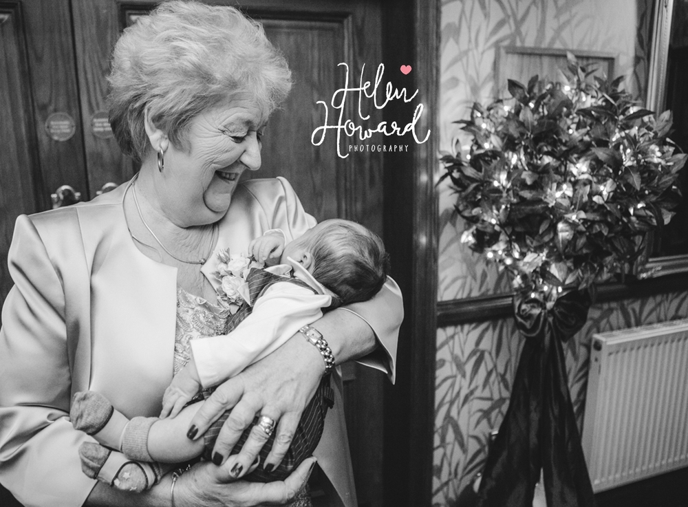 A Grandmother with her grandchild at a wedding