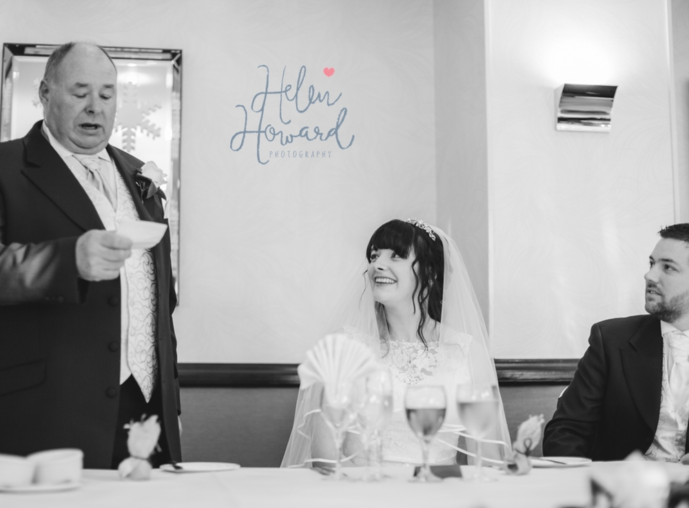 Bride looking at her father whilst he makes his speech