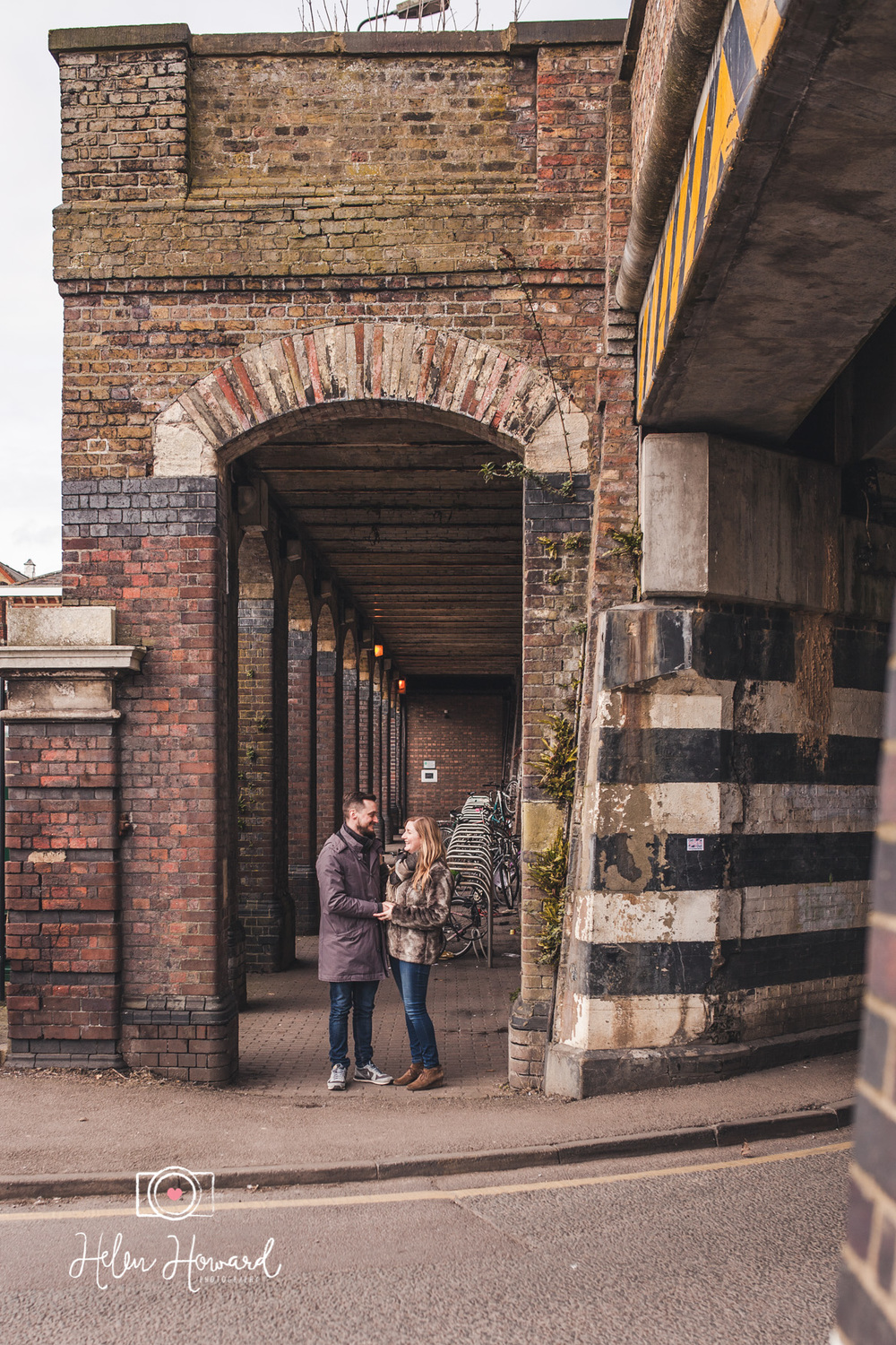 Couple posing by Berkhamsted Train station for their pre wedding photo shoot