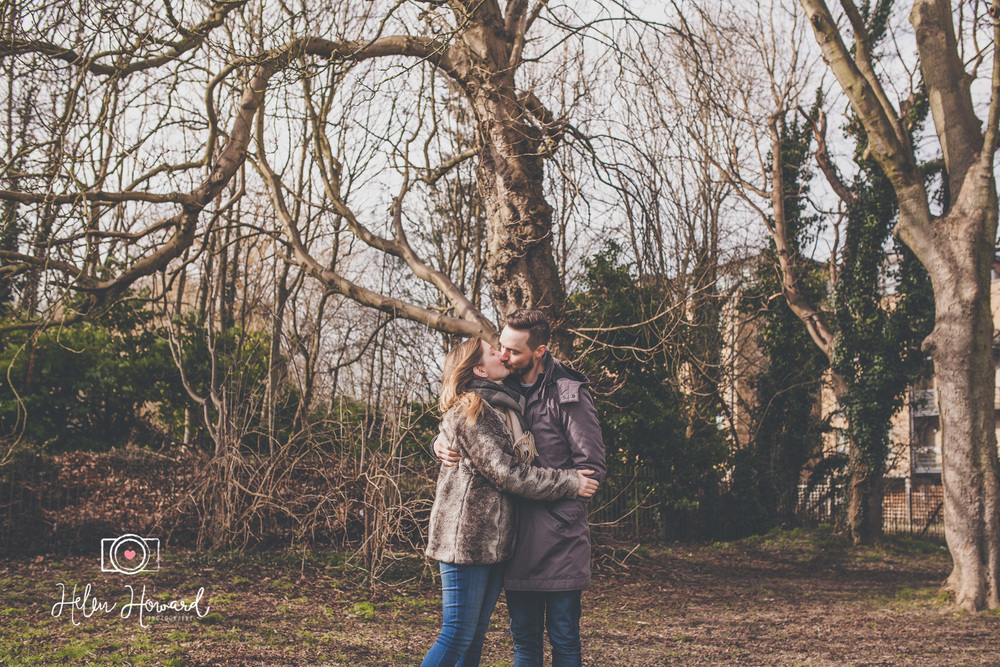 Couple kissing during engagement shoot in Berkhamsted by Helen Howard Photography