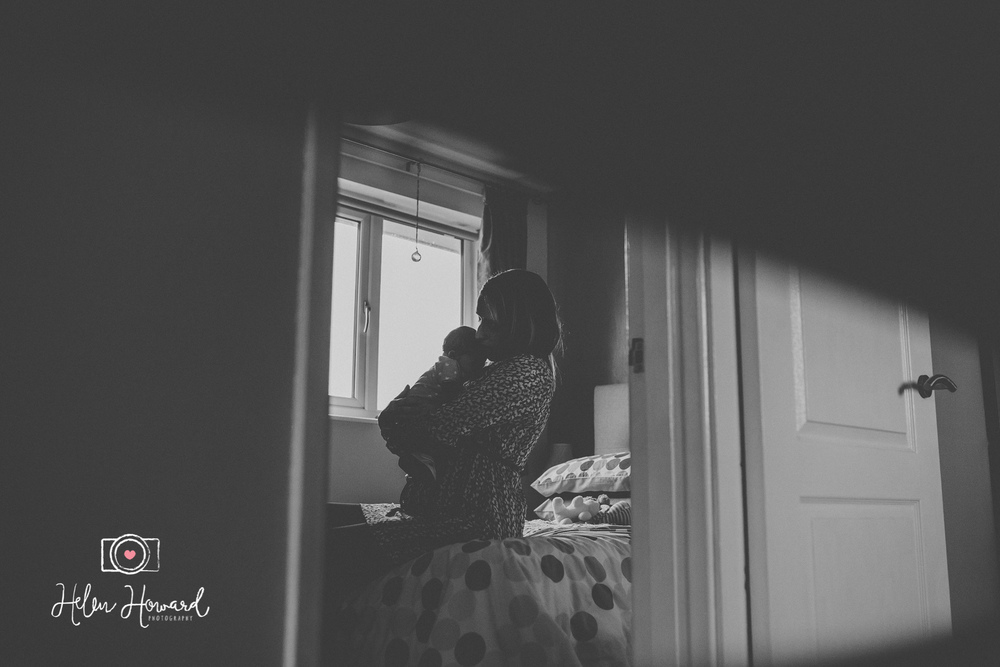 Black and white image of a mother and her baby silhouette