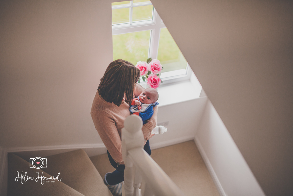 Mother and newborn baby documentary family portrait photography