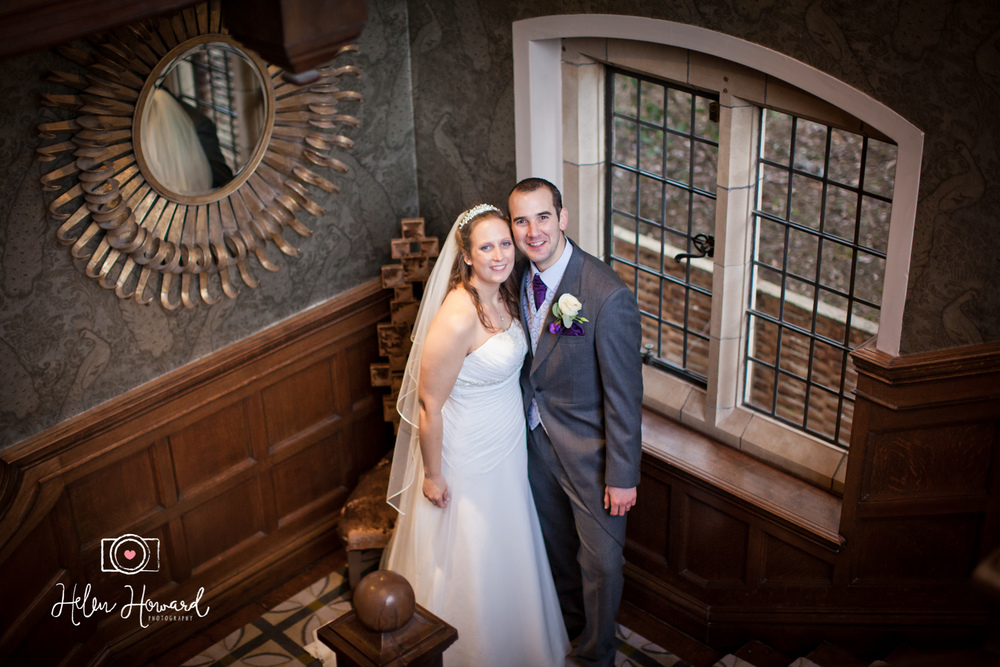 A bride and Groom on the staircase at Moxhull hall wedding photography in Staffordshire