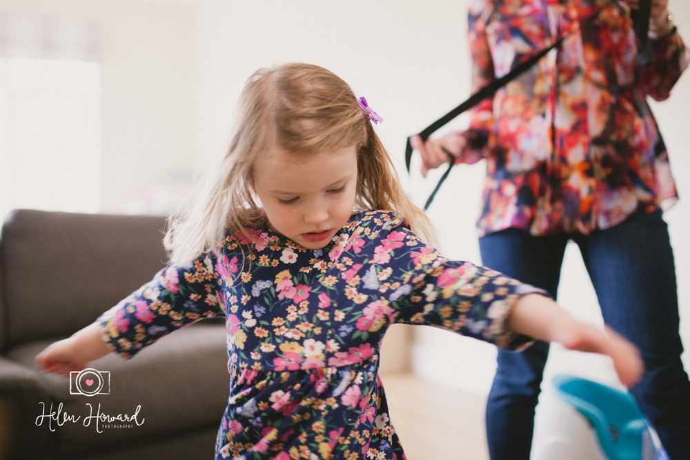 An image of a little girl spinning around