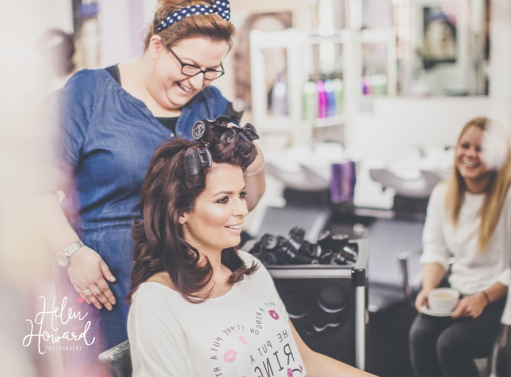Bridal hair being styled during the bridal preparation