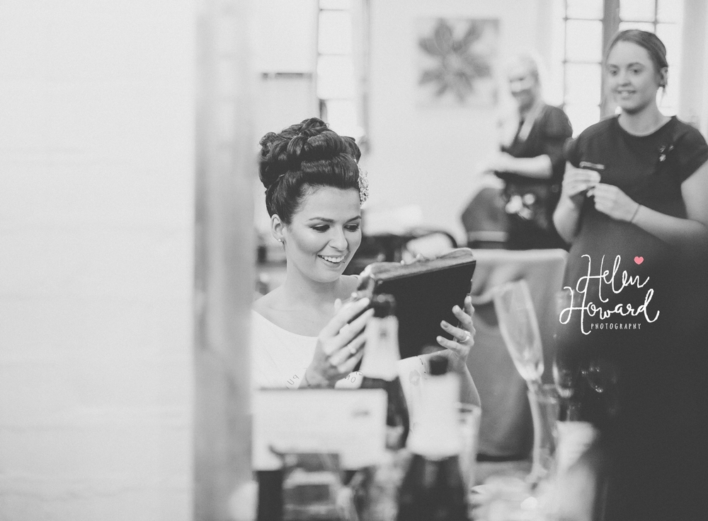 black and white image of a bride receiving a gift from her future husband