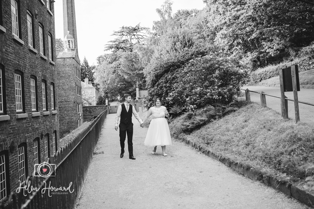 Bride and Groom walking at Quarry Bank Mill Weddings Styal-1.jpg