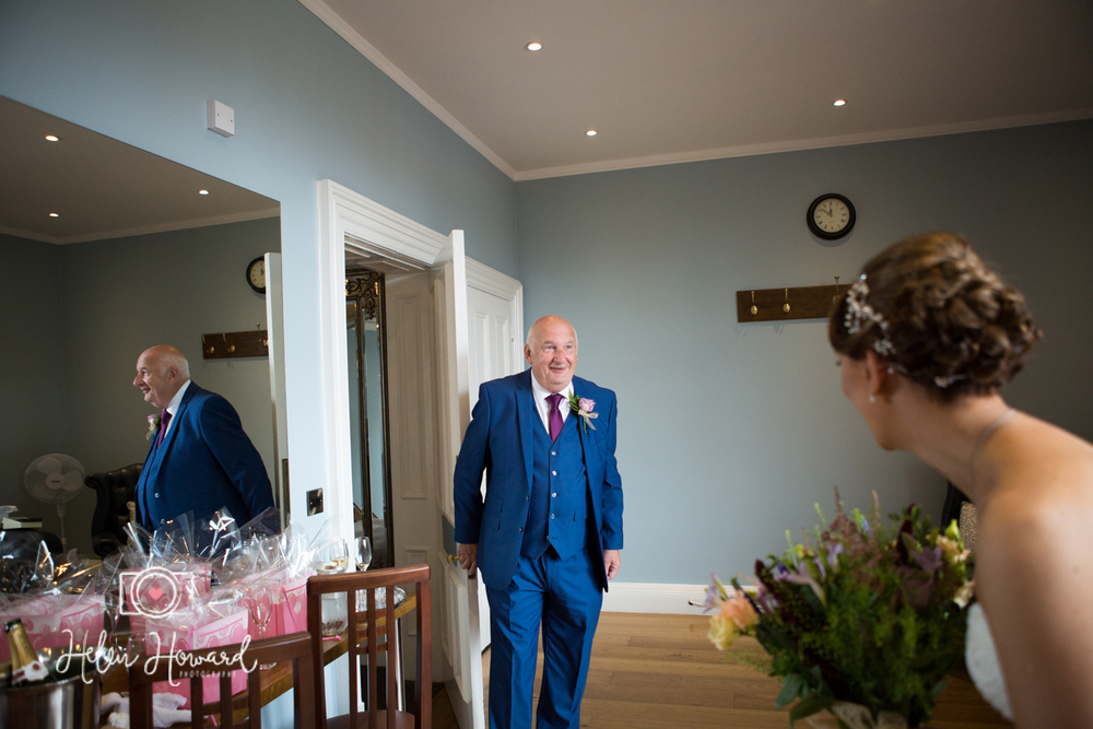 Brides Father seeing his daughter in her dress for the first time