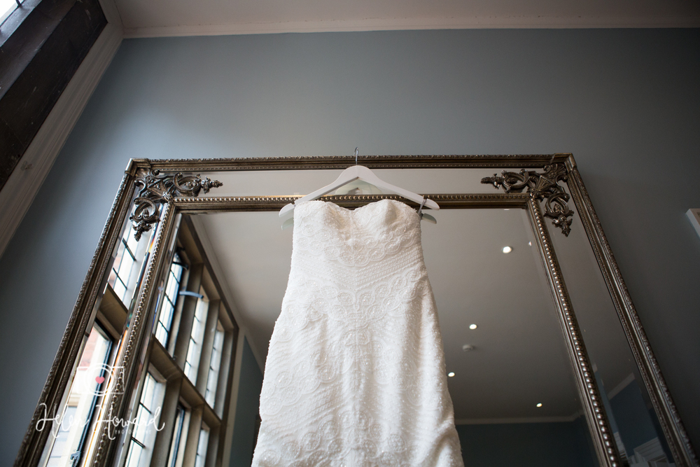 Dress hanging on a Mirror at Pendrell Hall Love is Not Enough Suite