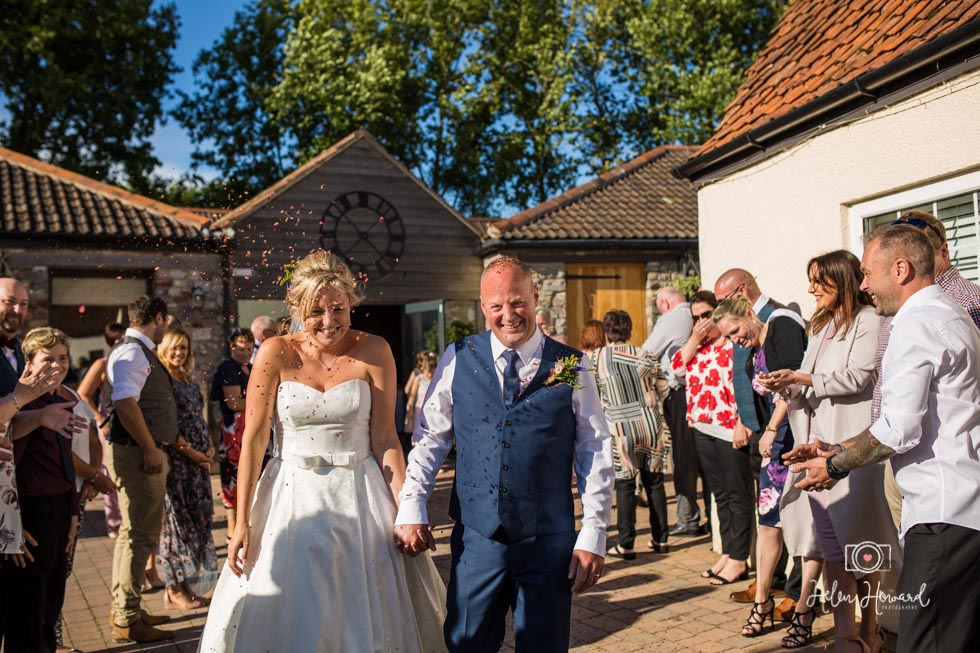 Confetti shot of Bride and Groom at Aldwick Court farm and Vineyard.jpg
