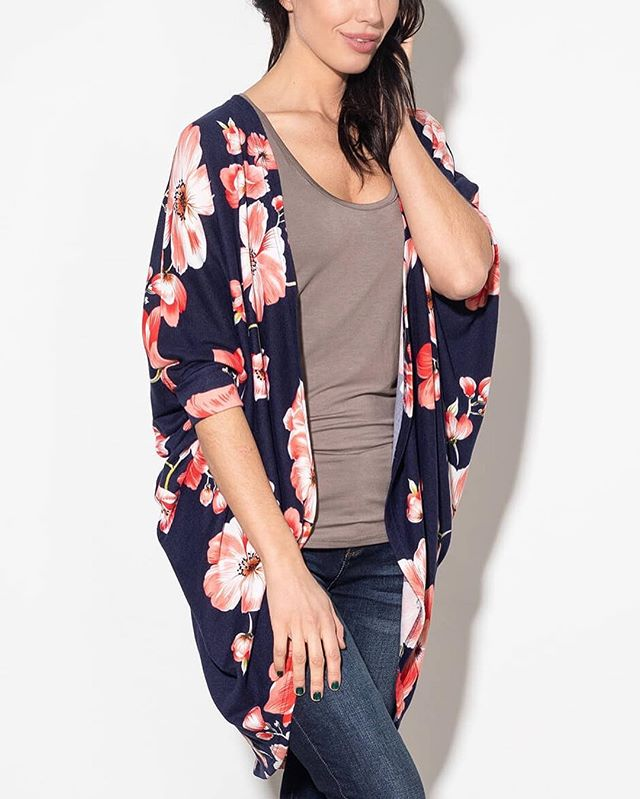 """This gorgeous Trendspotting Floral Cardi for Spring! . Sizes: One-Size Price: $59.99 (Retail: $64.95) Colour(s): Navy with Pink Flowers. . • One size • Open cardigan • Short sleeves • Loose fit • Center seam down back • Very soft material with stretch • 95% polyester, 5% elastane • Length approx 35"""" in back • Measurements approx 19"""" sleeve (from neckline). . Link to Shop my online boutique — Silver Icing — in my profile above. . . . . . . #silvericing #boutique #onlineshopping #clothing #fashion #cardigan #floral #springbreak #spring #casualstyle #clothingboutique #fashionista #style #yeglocal #yegstyle #shoppingonline #yegfashion #yegbusiness #clothes #style #love #flowers #gorgeous #weekendvibes #ootd #instafashion #streetstyle #womensfashion #yegstyle #instastyle"""