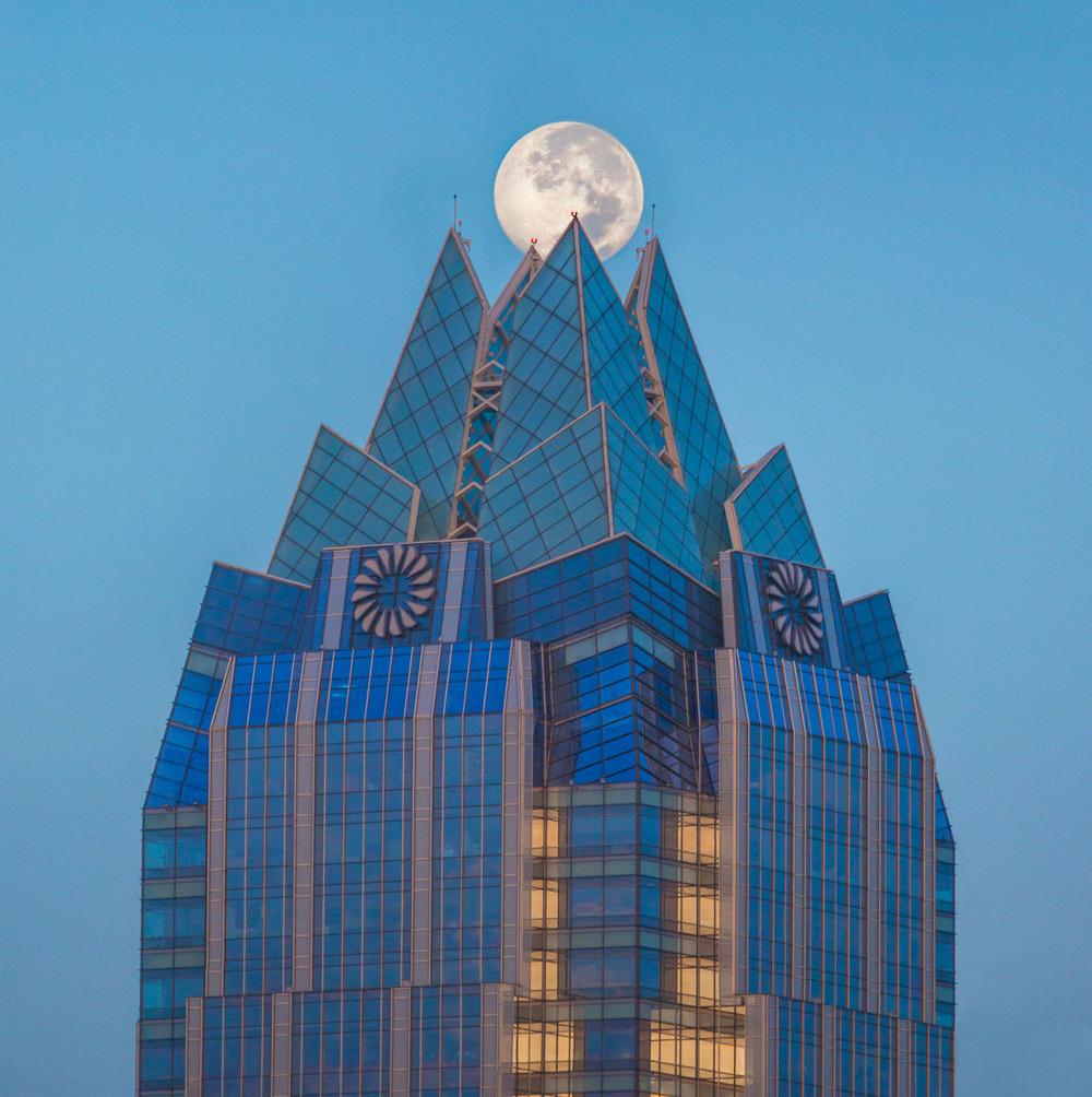 The Moon Setting on the Frost Tower. Downtown, Austin Texas