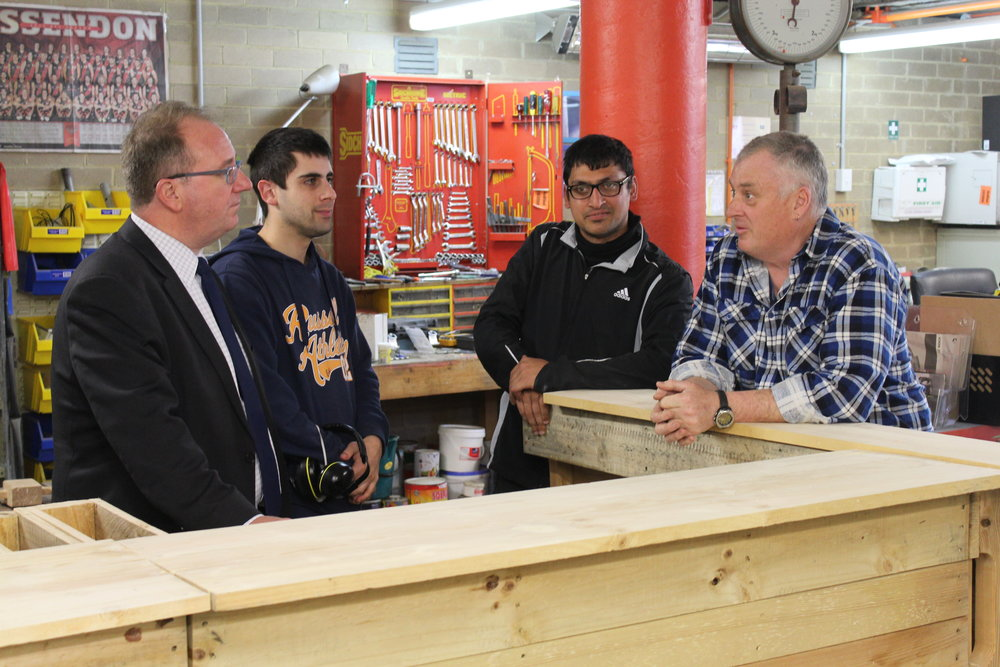Left to right of Hon David Feeney MP (Federal Member for Batman), Michael Conti (Participant), Robin Abedi (Participant) and David Johnson (Latrobe Lifeskills' Participant Support Worker) in the Lifeskills Workshop working on the pallet furniture.