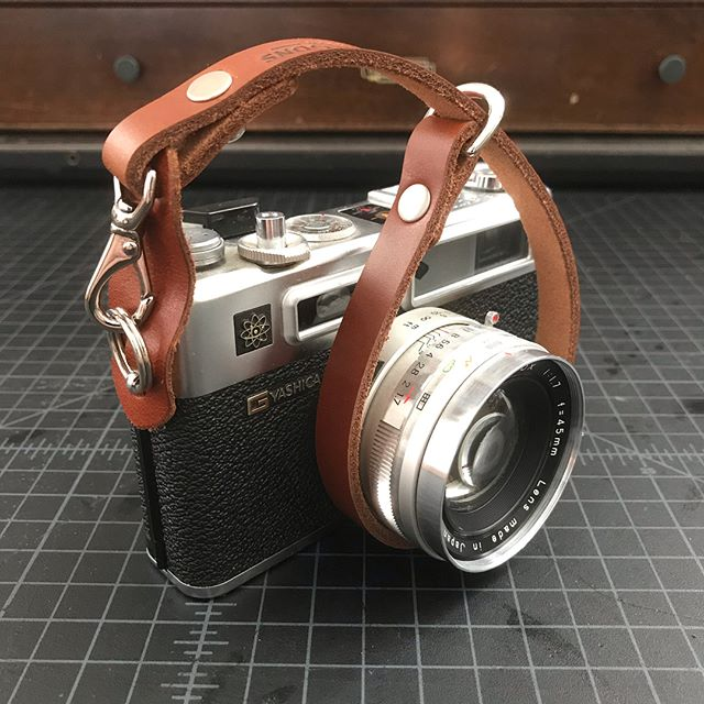 Talbott & Sons camera straps are custom made to our customers' specifications. This one is extra custom - honey color leather with nickel plated brass hardware and quick release