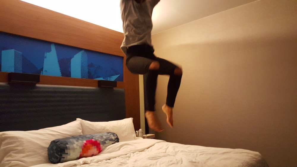 Hotel beds are made for jumping, dontcha think?